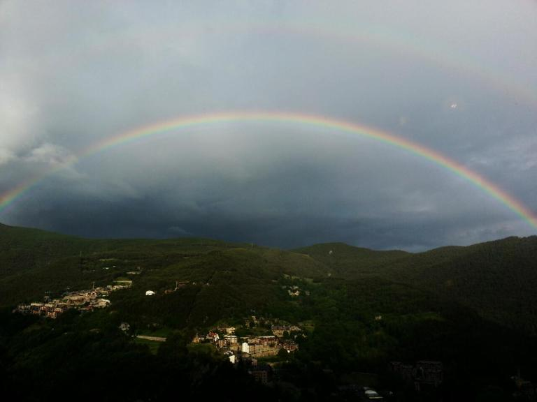 This is the TV. Two rainbows on my first day in Andorra and a small village under sunlight.